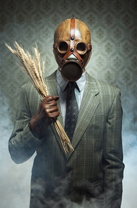 guy with gas mask holding toxic wheat