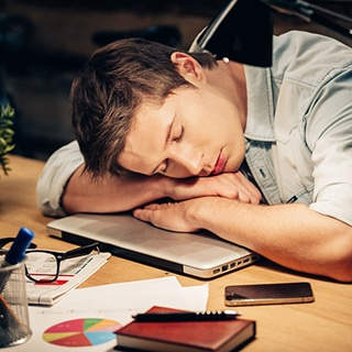 business owner sleeps at desk
